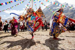 People participate in ritual Lama Dance in Tsum Valley.